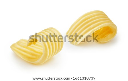 Butter curls or butter rolls isolated on white background