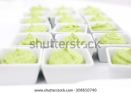 butter mixed with herbs in small plates at the buffet