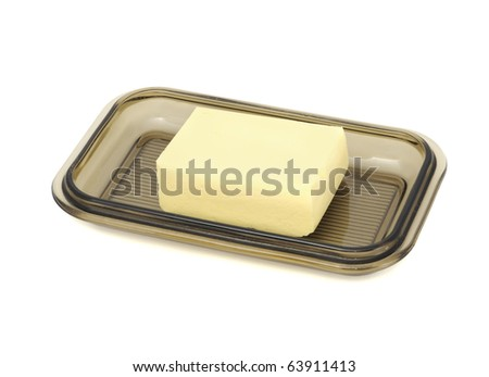 Butter on Glass Butterdish Isolated on White Background