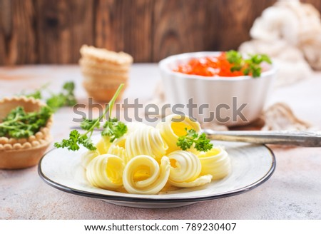 butter on plate and on a table, stock photo #789230407