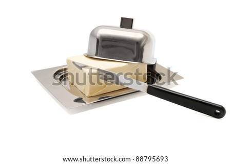 Butter on silver butter dish with knife