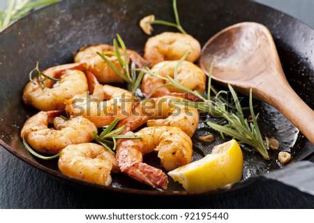 Butter prawns with fresh rosmarin and garlic - stock photo