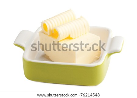 Butter with curls in a pan isolated on white