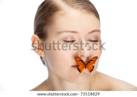 butterfly covering mouth of a young womans face