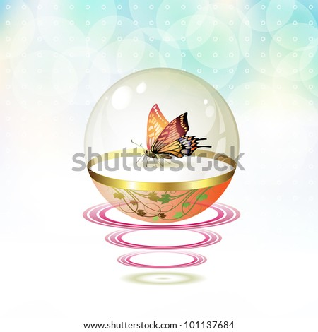 Butterfly isolated in glass globe suspended with waves