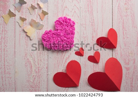 butterfly red heart and pink heart on a pink wooden texture #1022424793