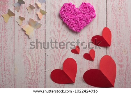 butterfly red heart and pink heart on a pink wooden texture #1022424916