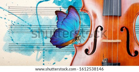 Butterfly, violin and notes. Blue morpho butterfly and violin. Melody concept. Photo of old music sheet in blue watercolor paint. Classical music concept. Violin close up. copy spaces Stock fotó ©