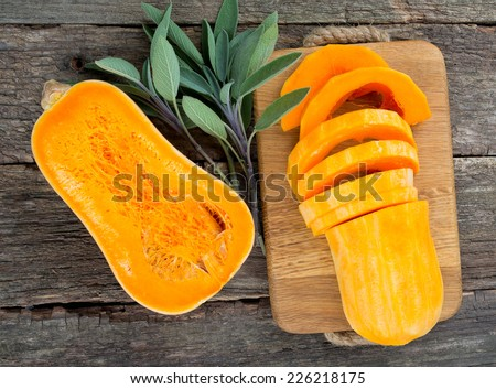 butternut squash over old wood background #226218175