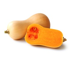 Butternut squash pumpkin cut in half with yellow flesh isolated on white background with clipping path.