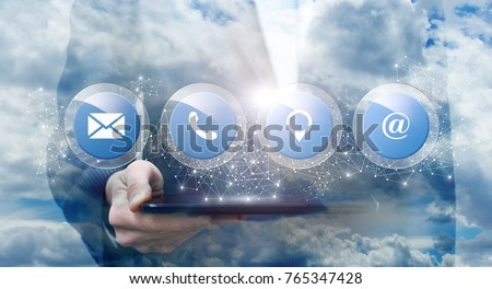 Button contacts us shows a businessman on the background of the sky.