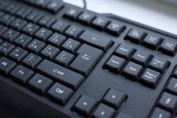 button enterter close-up. black computer wired keyboard.