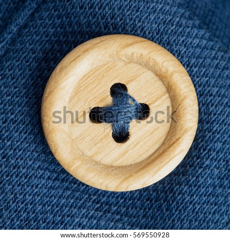 button on a polo t-shirt fabric texture