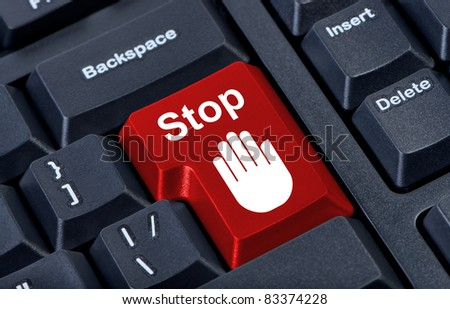 Button stop computer keyboard with hand icon.