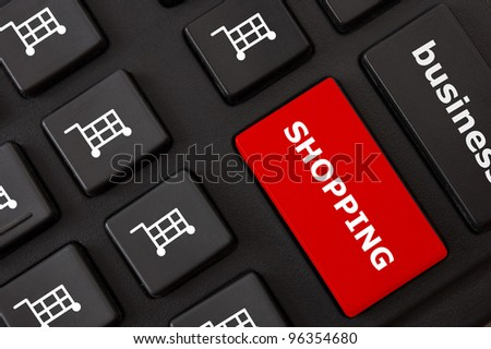 Button with shopping text and shopping trolley symbols on the modern keyboard (e-shopping concept).
