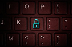 Button with the symbol of the closed lock on the keyboard. Concept of network security, virus protection, data protection.