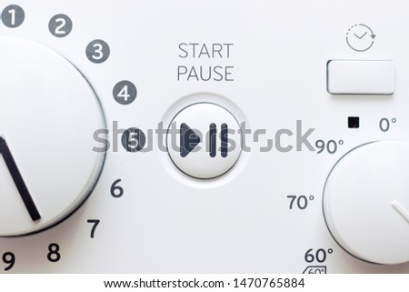 Buttons and knobs modern washing machine. #1470765884