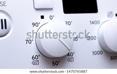 Buttons and knobs modern washing machine. #1470765887