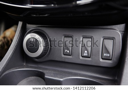 Buttons for controlling electronic safety systems and switching the modes of the all-wheel drive in a modern car #1412112206