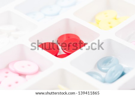buttons of different size, shape and color isolated on white