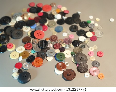 Buttons on clothes close-up. Multicolored buttons. Plastic buttons. #1312289771