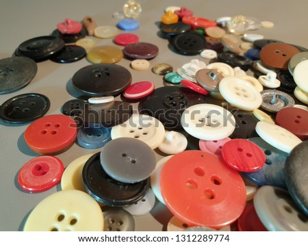 Buttons on clothes close-up. Multicolored buttons. Plastic buttons. #1312289774