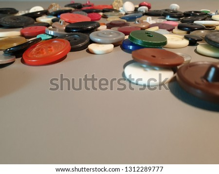 Buttons on clothes close-up. Multicolored buttons. Plastic buttons. #1312289777