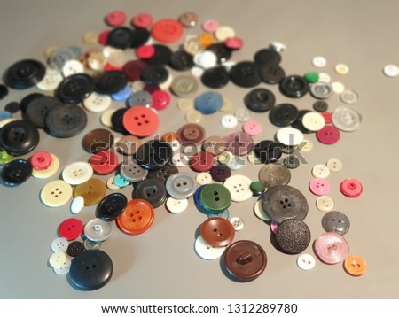 Buttons on clothes close-up. Multicolored buttons. Plastic buttons. #1312289780