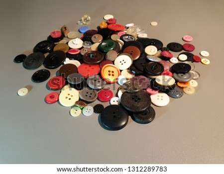 Buttons on clothes close-up. Multicolored buttons. Plastic buttons. #1312289783