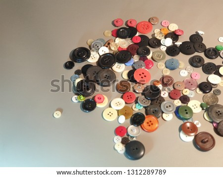 Buttons on clothes close-up. Multicolored buttons. Plastic buttons. #1312289789