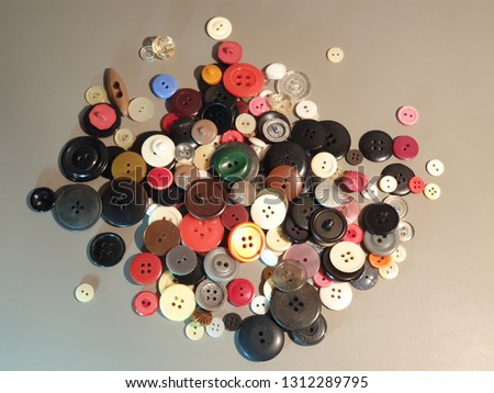 Buttons on clothes close-up. Multicolored buttons. Plastic buttons. #1312289795