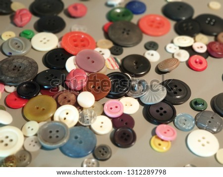 Buttons on clothes close-up. Multicolored buttons. Plastic buttons. #1312289798
