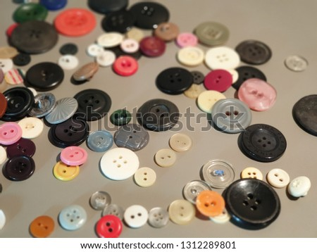 Buttons on clothes close-up. Multicolored buttons. Plastic buttons. #1312289801