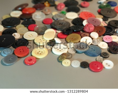 Buttons on clothes close-up. Multicolored buttons. Plastic buttons. #1312289804