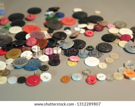Buttons on clothes close-up. Multicolored buttons. Plastic buttons. #1312289807