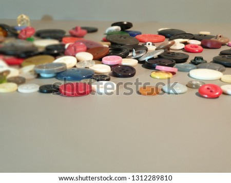 Buttons on clothes close-up. Multicolored buttons. Plastic buttons. #1312289810