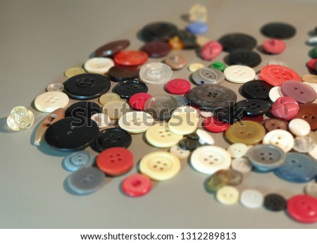 Buttons on clothes close-up. Multicolored buttons. Plastic buttons. #1312289813