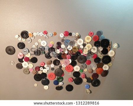 Buttons on clothes close-up. Multicolored buttons. Plastic buttons. #1312289816