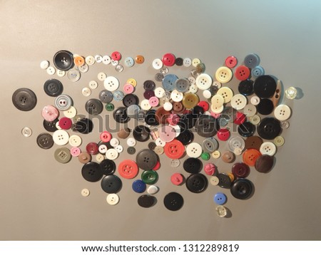 Buttons on clothes close-up. Multicolored buttons. Plastic buttons. #1312289819