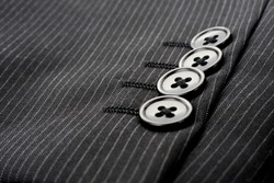 Buttons on sleeve of business suit