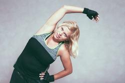 Buxom sporty fitness woman stretching body