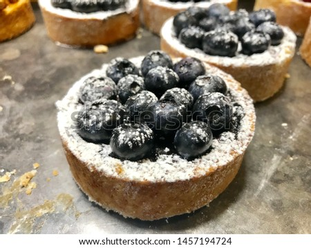 Buy concept shots of different alternative composition decorated with fruits in the forest making red raspberries black grapes in the evening single beauties made round tort muffins wonderful singles