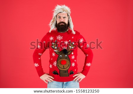 Buy festive clothing. Sweater with deer. Hipster bearded man wear winter sweater and hat. Happy new year. Join holiday party craze and host Ugly Christmas Sweater Party. Winter party outfit.