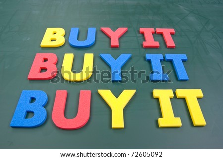 Buy it, colorful words on blackboard, marketing concept