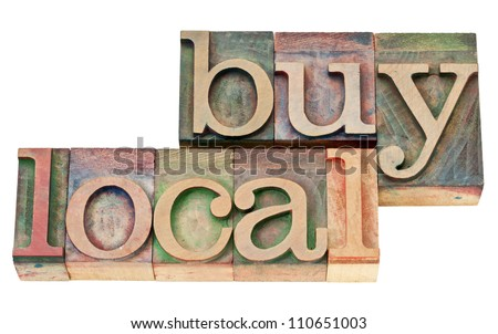 buy local - isolated text in vintage  letterpress wood type - stock photo