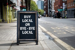 BUY LOCAL OR BYE - BYE LOCAL. Foldable advertising poster on the street