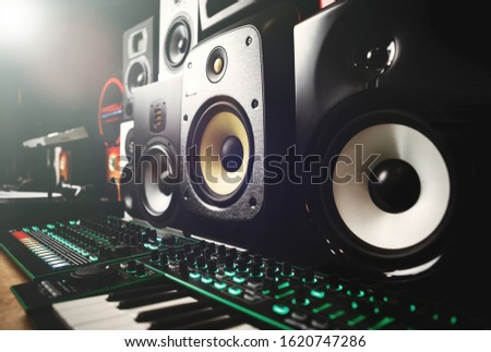 Buy new speakers in music store.Hi fi sound system for sale in dj shop.Professional speaker box to listen to the music in high quality.New sound recording studio audio equipment