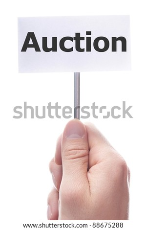 buy or sell on auction concept with hand holding paper - stock photo