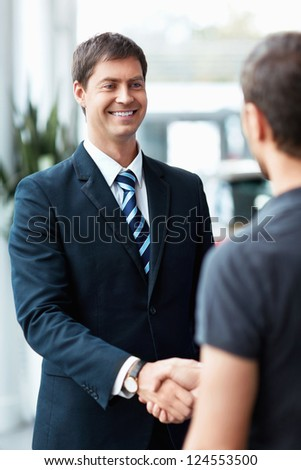 Buyer and seller shake hands - stock photo