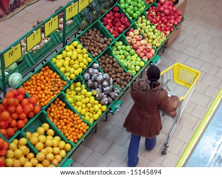buyer chooses fruits in the supermarket